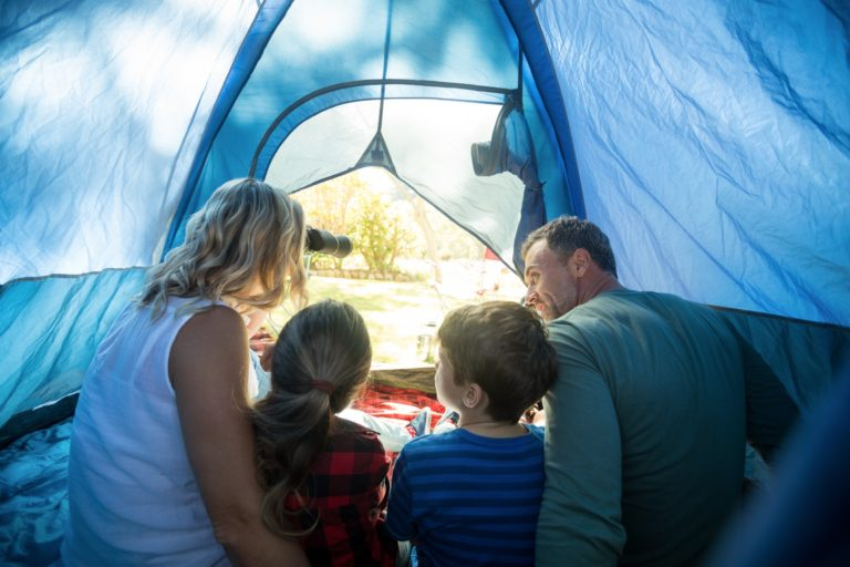 Family sitting in the tent